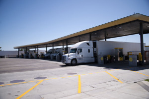 Semi Trucks with trailers are at filling station for diesel refu