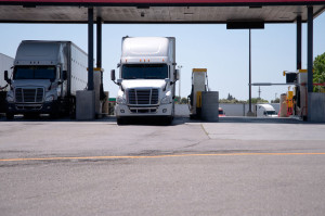 Semi Trucks are at the gas station for refueling